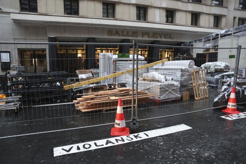 """A graffiti in front of the venue of the Cesar Awards ceremony reads """"Violanski"""", playing with the French word for rape and the name of Roman Polanski, Thursday, Feb. 27, 2020 in Paris. French women's rights activists are plastering banners to protest multiple nominations for Roman Polanski at the Cesar Awards ceremony, France's equivalent of the Oscars. This year's Cesars have been shaken by boycott calls since the nominations for Polanski's """"An Officer and a Spy,"""" because a French woman recently accused Polanski of raping her in the 1970s, which he denies. (AP Photo/Thibault Camus)"""