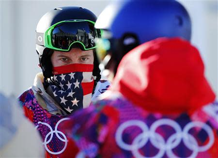 U.S. snowboarder Shaun White waits in line during a breakdown of the chairlift at snowboard slopestyle training for the 2014 Sochi Winter Olympics in Rosa Khutor, February 3, 2014. REUTERS/Mike Blake