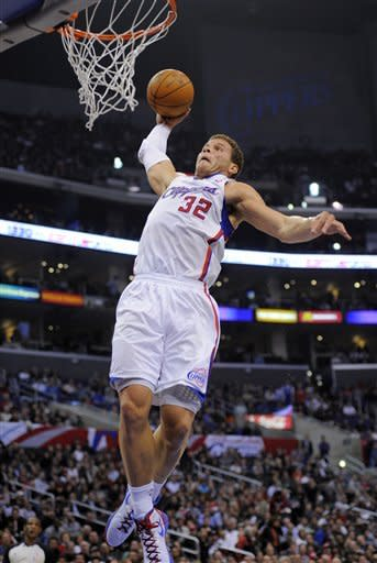 Los Angeles Clippers forward Blake Griffin goes up for a dunk during the first half of an NBA basketball game against the Dallas Mavericks, Wednesday, Jan. 18, 2012, in Los Angeles. (AP Photo/Mark J. Terrill)