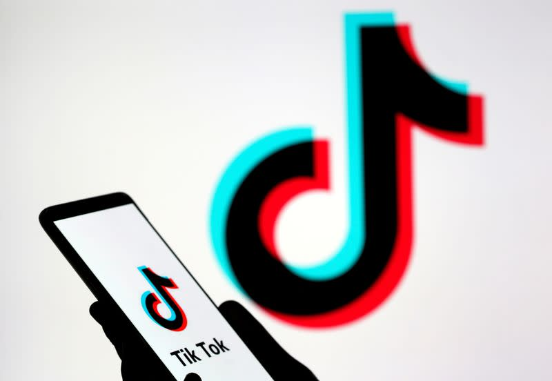 FILE PHOTO: A person holds a smartphone with TikTok logo displayed in this picture illustration