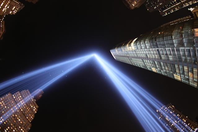 """<p>In a photo taken with a fisheye lens, the two beams of light meet in the art installation """"The Tribute in Light"""" projecting in the night sky over Manhattan on Sept. 11, 2017. (Gordon Donovan) </p>"""