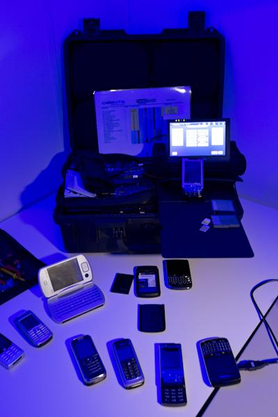 FILE - In this Jan. 11, 2013, file photo, equipment to analyze mobile and smart phones is displayed in a lab during a media tour of the Cybercrime Center at Europol headquarters in The Hague, Netherlands. If a purse with $900 is stolen, the victim probably would call the police. If a computer hacker steals $900 from that same person's bank account, what then? Call the police? Could they even help? As it is now, local police don't have widespread know-how to investigate cybercrimes. They rely heavily on the expertise of the federal government, which focuses on large, often international cybercrimes. What's missing is the first response role, typically the preserve of local police departments that respond to calls for help from individuals and communities. They're looking to boost their expertise to be able to respond to high-tech crimes that are expected to only get worse. (AP Photo/Peter Dejong, File)