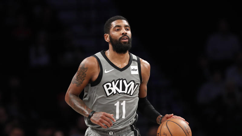 Brooklyn Nets guard Kyrie Irving (11) takes the ball down court during the first quarter of an NBA basketball game against the Utah Jazz, Tuesday, Jan. 14, 2020, in New York. (AP Photo/Kathy Willens)