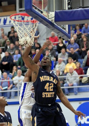 Murray State's Ivan Aska (42) shoots a layup against an Eastern Illinois defender during the first half of an NCAA college basketball game on Friday, Dec. 30, 2011, in Charleston, Ill. (AP Photo/Stephen Haas)