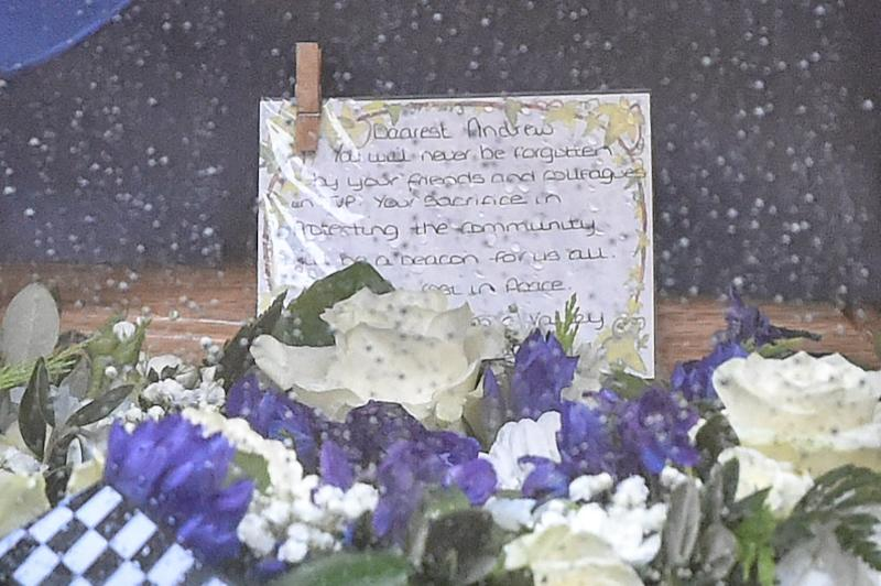 """You will never be forgotten"": A note written by Pc Harper's colleagues is placed on the coffin. (PA)"
