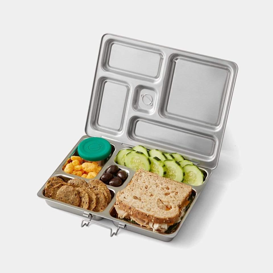 """For serious movers and shakers, this sleek steel lunch kit will undoubtedly keep your nutritious eats secure. Plus, the two leakproof containers will make sure everything stays in place. $60, PlanetBox. <a href=""""https://www.planetbox.com/products/planetbox-rover-lunchbox"""" rel=""""nofollow noopener"""" target=""""_blank"""" data-ylk=""""slk:Get it now!"""" class=""""link rapid-noclick-resp"""">Get it now!</a>"""