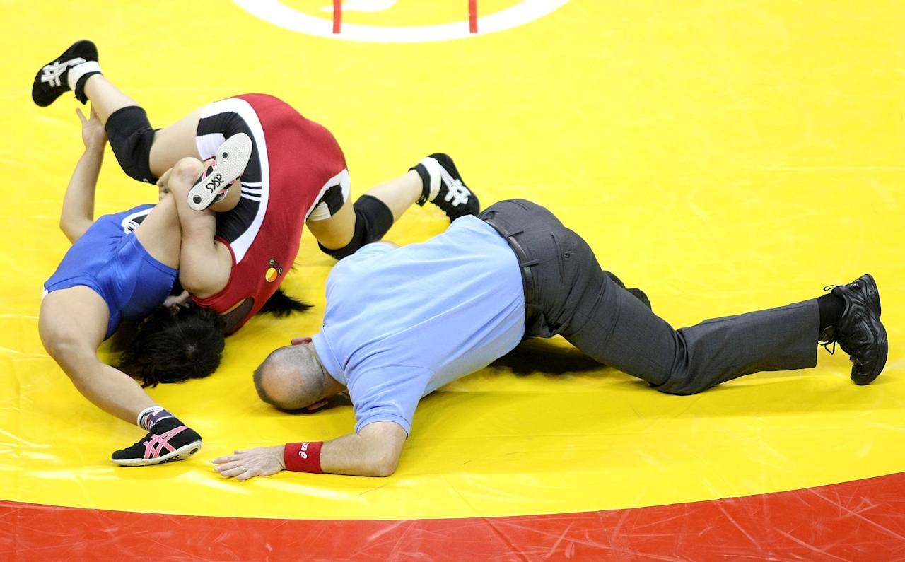 LAS VEGAS - JUNE 13:  Clarissa Chun (blue) wrestles Patricia Miranda (blue) in the Championship match for 48 kg during the USA Olympic trials for Wrestling and Judo on June 13, 2008 at the Thomas and Mack Center in Las Vegas, Neveda.  (Photo by Jonathan Ferrey/Getty Images)