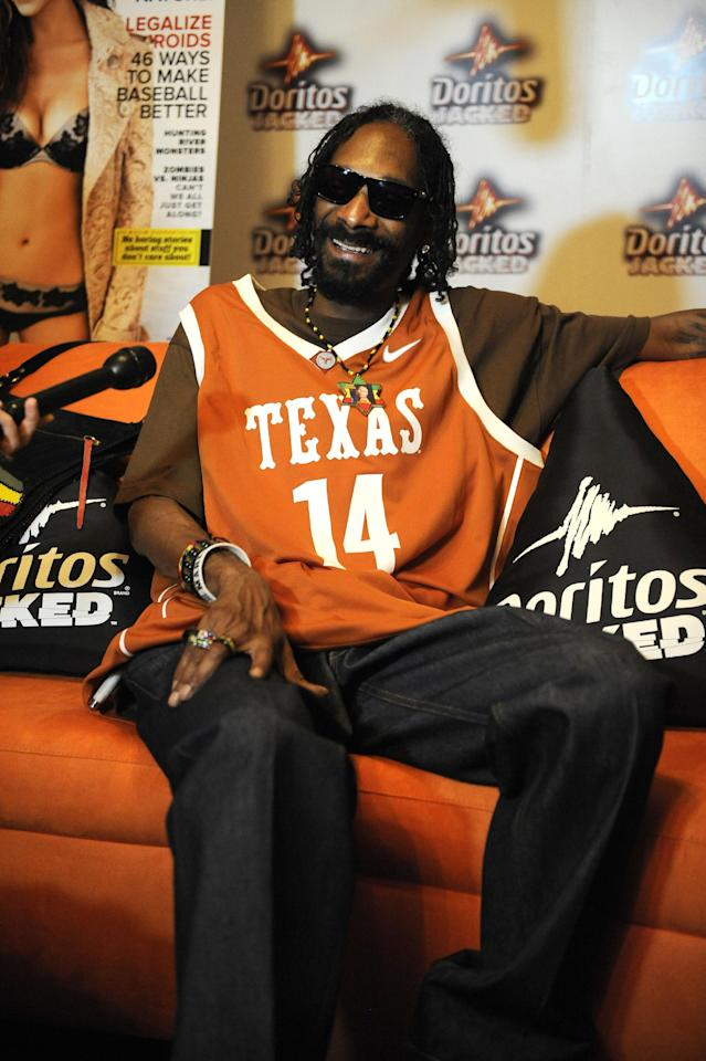 COMMERCIAL IMAGE - In this photograph taken by AP Images for Doritos, Snoop Dogg relaxes backstage at the Doritos JACKED Maxim Party in Austin, Texas, Thursday, March 15, 2012. The 56-foot-tall vending machine JACKED Stage was unveiled at SXSW to debut amped up new Doritos JACKED chips. (Darren Abate/AP Images for Doritos)