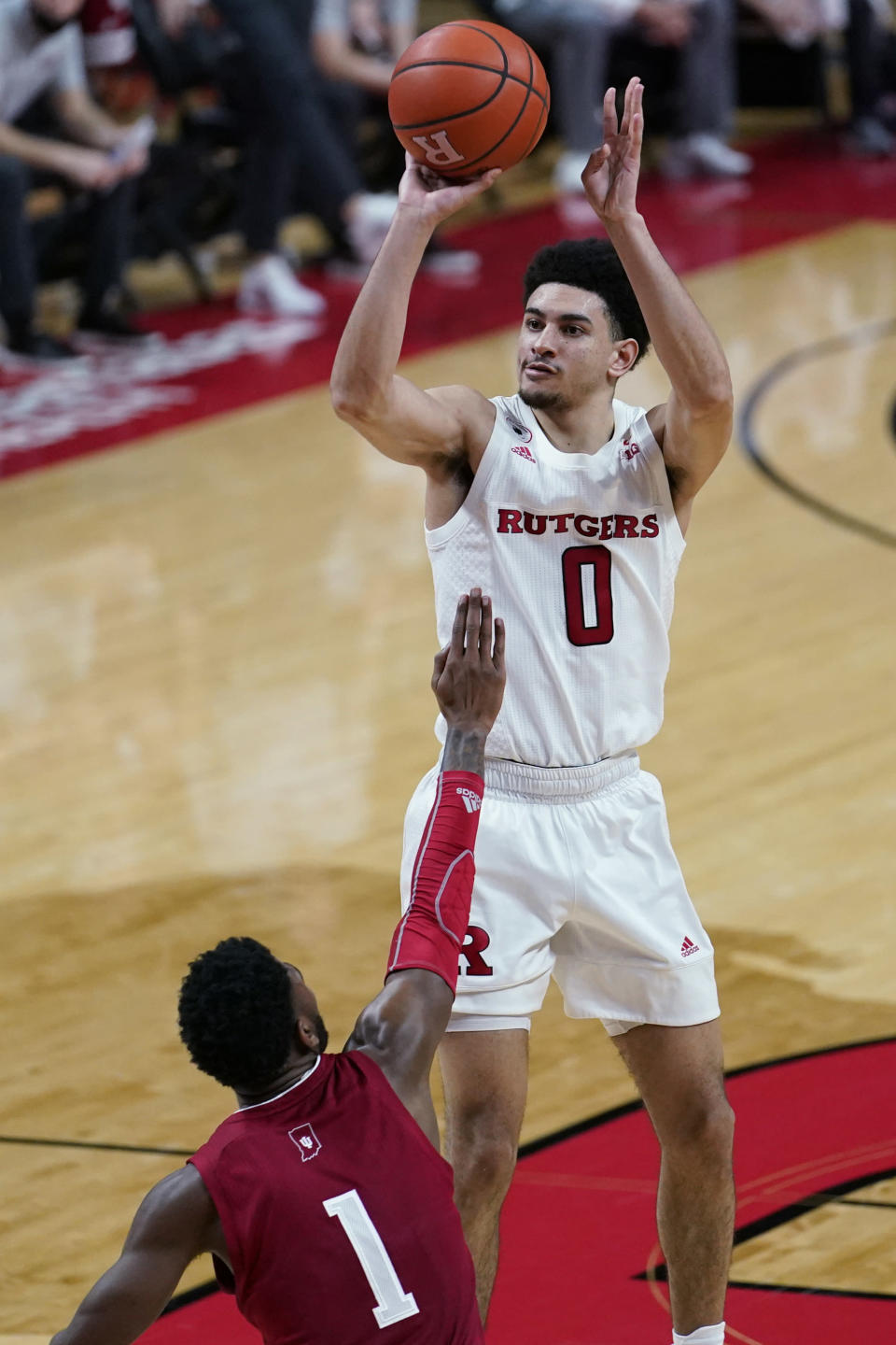 Rutgers guard Geo Baker (0) shoots over Indiana guard Al Durham (1) during the second half of an NCAA college basketball game Wednesday, Feb. 24, 2021, in Piscataway, N.J. (AP Photo/Kathy Willens)