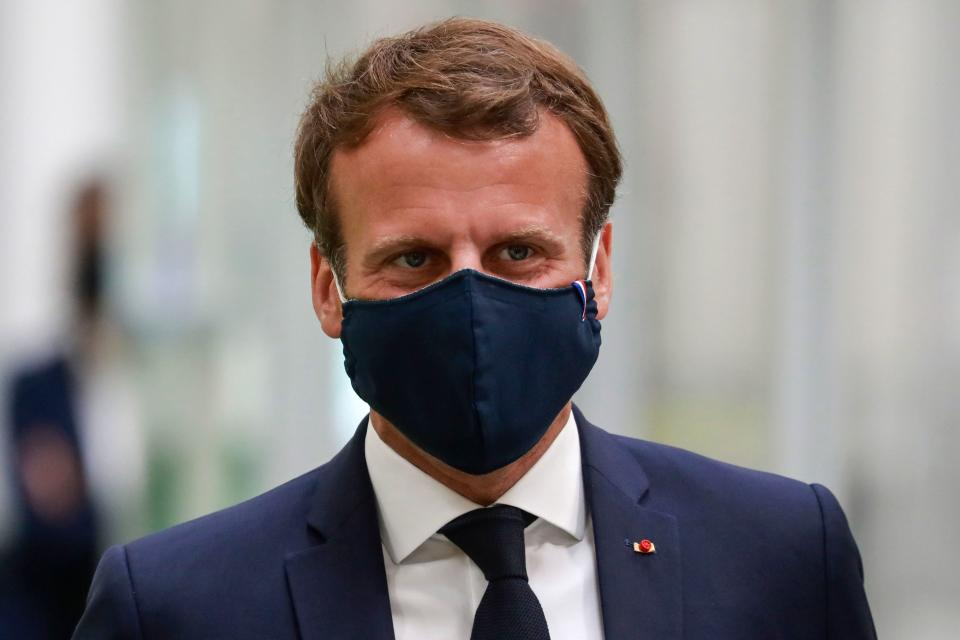 French President Emmanuel Macron, wearing a protective face mask, visits a factory of manufacturer Valeo in Etaples, near Le Touquet, northern France on May 26, 2020 as part of the launch of a plan to rescue the French car industry. (Photo by Ludovic MARIN / POOL / AFP) (Photo by LUDOVIC MARIN/POOL/AFP via Getty Images)