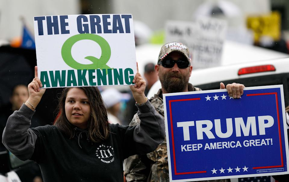QAnon conspiracy theorists hold signs during a protest at the state Capitol in Salem, Oregon, May 2, 2020. (Photo: John Rudoff/Anadolu Agency via Getty Images)