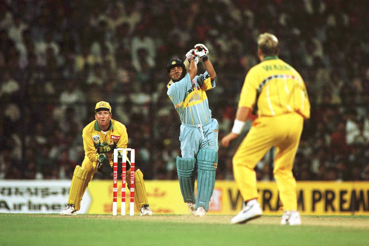 27 Feb 1996:  Sachin Tendulkar of India plays a shot off the bowling of Shane Warne of Australia during the Cricket World Cup match between Australia and India in Bombay, India. Mandatory Credit: Shaun Botterill/Allsport