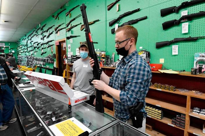 Hyatt Gun Shop salesmen Ted Shore, right, and Ian Mahathey assemble a shotgun for a customer on Wednesday, January 20, 2021. The store is seeing unprecedented demand for guns and ammunition, owner Larry Hyatt said.