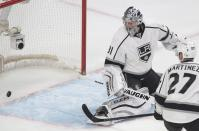 Los Angeles Kings goaltender Martin Jones is scored on by Montreal Canadiens' P.K. Subban (not shown) as teammate Alec Martinez looks for the rebound during the first period of an NHL hockey game, Friday, Dec. 12, 2014 in Montreal. (AP Photo/Canadian Press, Graham Hughes)