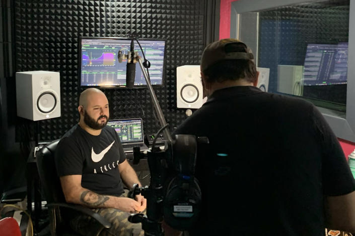 Image: Marketing and music entrepreneur Mike Zeimer, 35, from Dallas records an instructional stock trading video in his production studio. (Anna Marie Taylor Cavitt)
