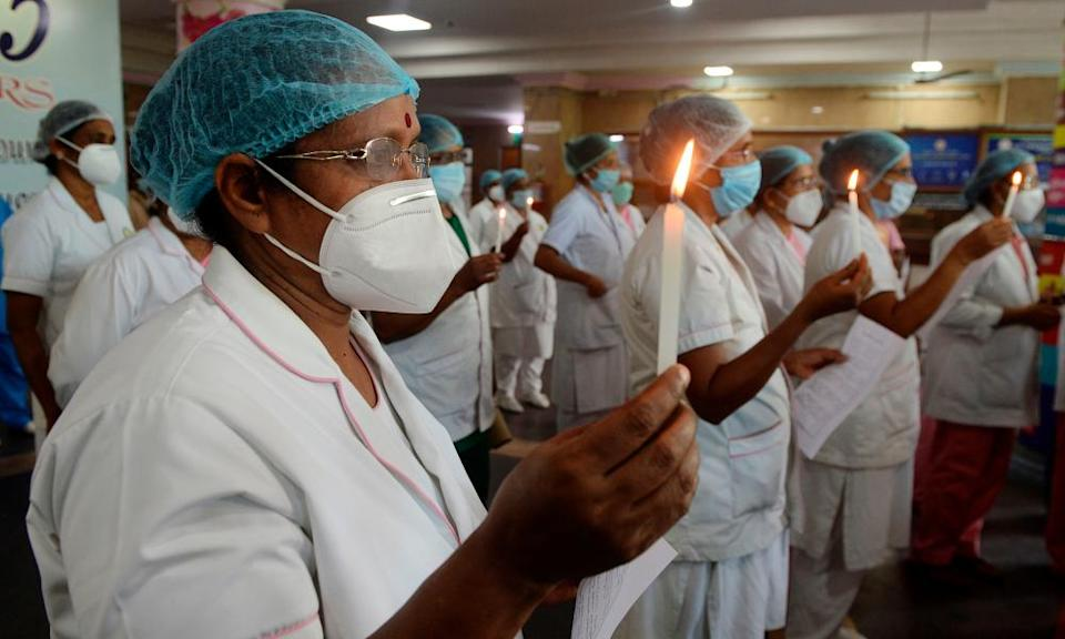 Nurses light candles at Rajiv Gandhi hospital in Kochi to mark international nurses day.