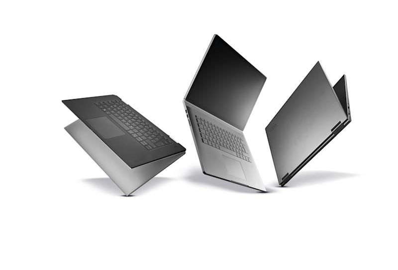 A group of premium two-in-one laptop computers, including (L-R) a Lenovo Yoga 730-15IKb, Microsoft Surface Book 2 and a Dell XPS 15 2-in-1, taken on October 5, 2018. (Photo by Neil Godwin/T3 Magazine/Future via Getty Images)