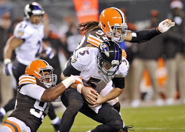 Cleveland Browns defensive end Armonty Bryant, left, and outside linebacker Jabaal Sheard (97) sack Baltimore Ravens quarterback Joe Flacco (5) in the second quarter of an NFL football game Sunday, Nov. 3, 2013. (AP Photo/David Richard)