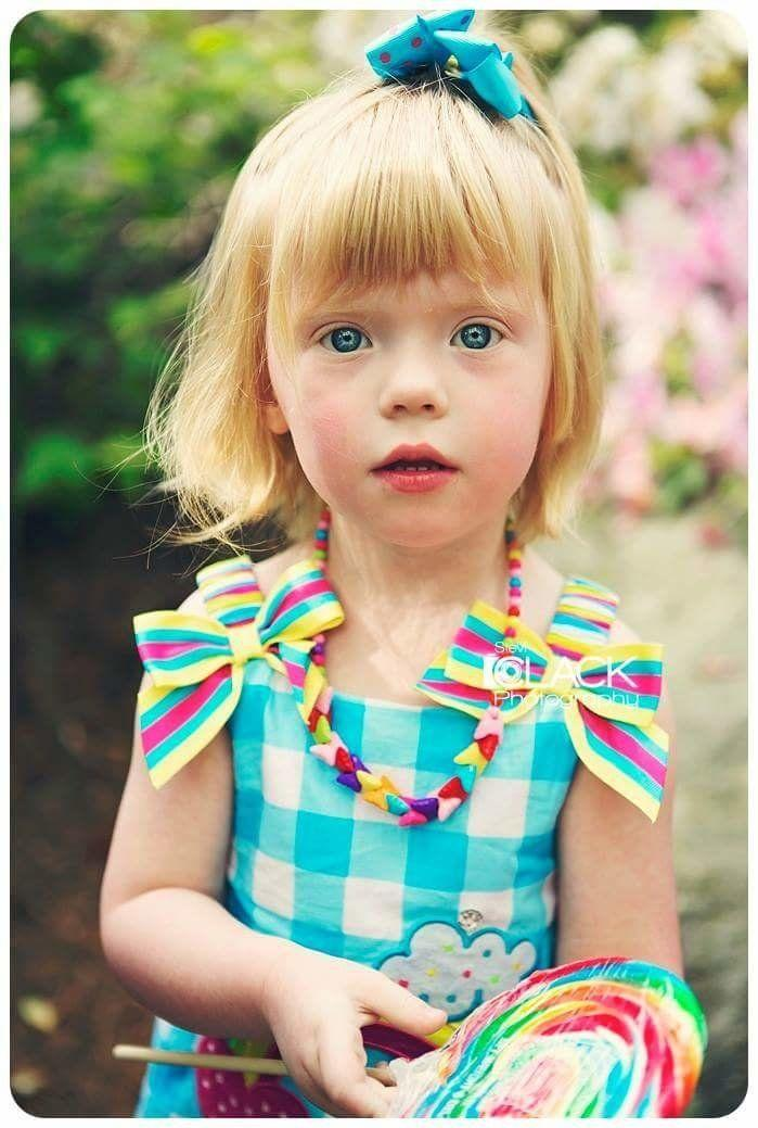 """Zoe was diagnosed with autism at 23 months old. We had known for a long time prior to the testing that she had autism, but who was to say she wasn't just different than the rest. Every day is unpredictable. Zoe never has a boring day. I remember waiting YEARS to hear her first word. When she said it, I pulled the car over and cried so hard. She flapped her arms and did her self-stimming tongue thrusting, and I joined in too! She is just like every other child. She has good days and bad days. She has milestones and regressions. It's just that autism gives her that extra push to do things on a larger scale. I think she has started to learn that she is different than her classmates, and she has already been the target of bullying. Autism prevents her from understanding that bullies are trying to hurt her. She still will walk up to them and slowly make eye contact, smile, stick her hand out, say 'Hi friend! I'm Zoe Grace!', lick their cheek and skip away. #DifferentNotLess"""