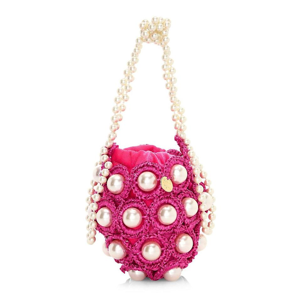 """If there's one """"can't wait to gift"""" piece on this list, it's this gorgeous pearl bag. Made to order in Portugal, it's a playful classic she'll enjoy for years to come. $595, Saks Fifth Avenue. <a href=""""https://shop.saksfifthavenue.com/product/alameda-turquesa-mini-hana-faux-pearl-woven-top-handle-bag-0400012216144.html?dwvar_0400012216144_color=PINK"""" rel=""""nofollow noopener"""" target=""""_blank"""" data-ylk=""""slk:Get it now!"""" class=""""link rapid-noclick-resp"""">Get it now!</a>"""