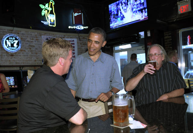 President Barack Obama talks with patrons as he stops for a beer at Ziggyís Pub and Restaurant in Amherst, Ohio, Thursday, July 5, 2012. Obama is on a two-day bus trip through Ohio and Pennsylvania. (AP Photo/Susan Walsh)