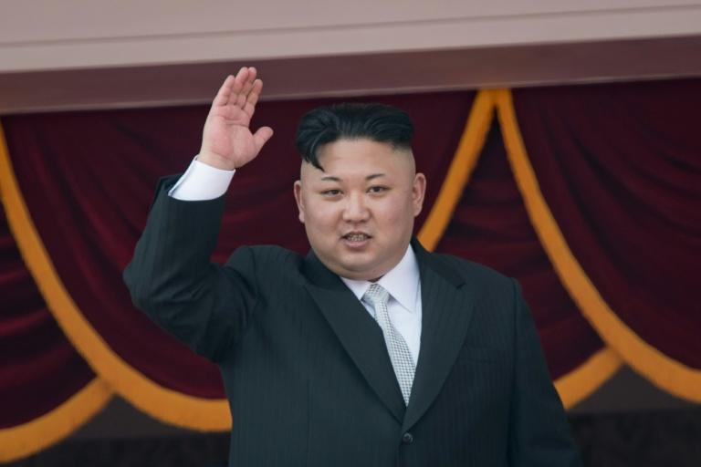 North Korean leader Kim Jong-Un waves from a balcony of the Grand People's Study house during a military parade in Pyongyang