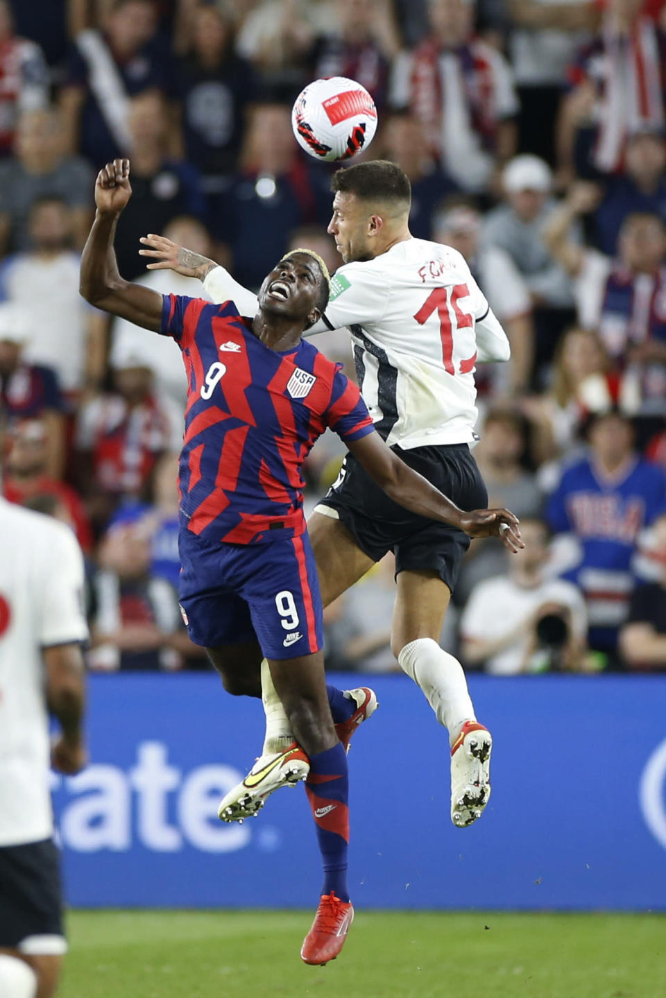 United States' Gyasi Zardes, left, and Costa Rica's Francisco Calvo jump for a head ball during the second half of a World Cup qualifying soccer match Wednesday, Oct. 13, 2021, in Columbus, Ohio. The United States won 2-1. (AP Photo/Jay LaPrete)
