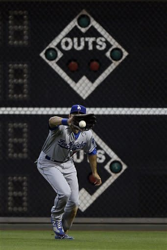 Los Angeles Dodgers right fielder Andre Ethier catches a fly out by Philadelphia Phillies' Hunter Pence in the first inning of a baseball game, Monday, June 4, 2012, in Philadelphia. (AP Photo/Matt Slocum)