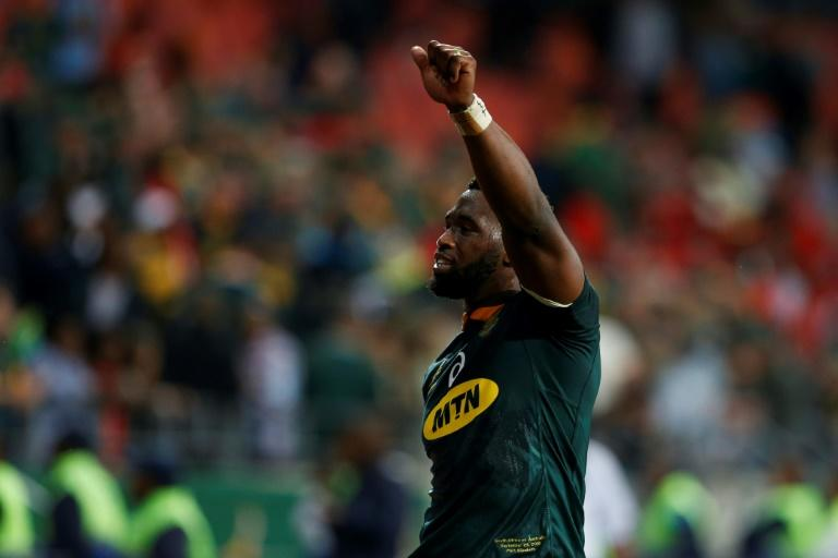 Siya Kolisi South Africa's black captain lifting the Rugby World Cup trophy would be a hugely symbolic moment former Boks assistant coach Alan Solomons told AFP (AFP Photo/GIANLUIGI GUERCIA)