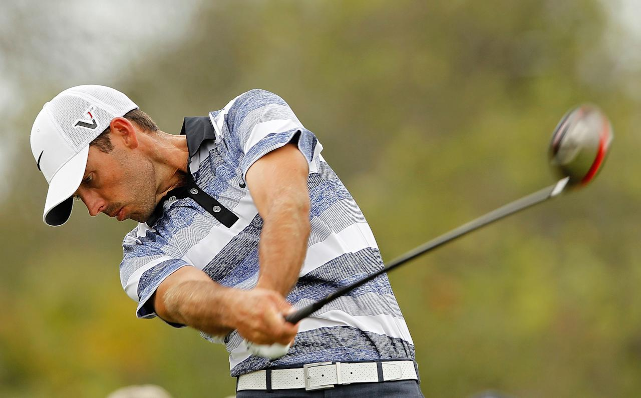 MIAMI, FL - MARCH 08:  Charl Schwartzel of South Africa hits his tee shot on the fifth hole during the first round of the 2012 World Golf Championships Cadillac Championship at Doral Golf Resort And Spa on March 8, 2012 in Miami, Florida.  (Photo by Mike Ehrmann/Getty Images)