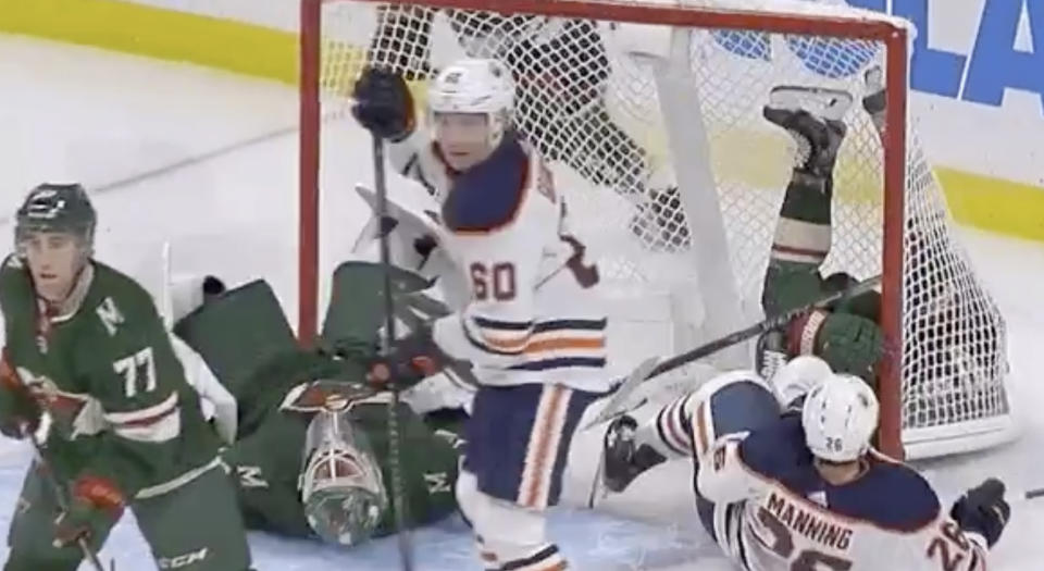 Minnesota goaltender Devan Dubnyk was the true victim after teammate Ryan Donato and Brandon Manning of the Edmonton Oilers got tied up and slid into him on Tuesday night. (Twitter//@hockeywildernes)