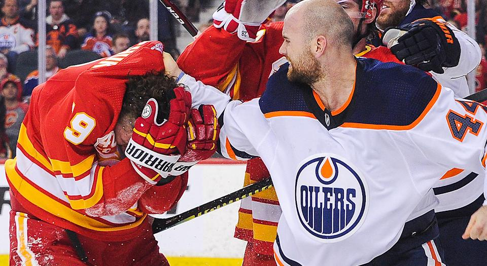 CALGARY, AB - JANUARY 11: Zack Kassian #44 of the Edmonton Oilers fights Matthew Tkachuk #19 of the Calgary Flames during an NHL game at Scotiabank Saddledome on January 11, 2020 in Calgary, Alberta, Canada. (Photo by Derek Leung/Getty Images)