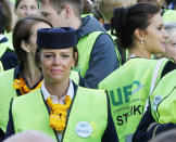 Cabin attendants take part in a demonstration at the Frankfurt airport as the flight attendants of German Lufthansa airline went on a seven hour strike, Friday, Aug. 31, 2012, in Frankfurt, Germany. Lufthansa flight attendants are on strike at Germany's busiest airport, causing the cancellation of dozens of flights. The cabin crews walked off the job early Friday morning at Frankfurt airport in an eight-hour strike that is to last until early afternoon. The UFO union says it will continue staging short-term strikes until its demands for better pay and conditions for some 18,000 cabin crew at the airline, Germany's largest, are met. Lufthansa says it has canceled about a quarter of the 360 flights at the airport that were scheduled during the strike hours, all short and middle-distance routes. (AP Photo/Michael Probst)