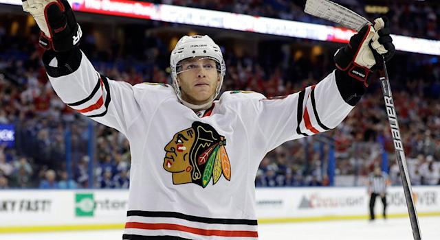 <p>The Blackhawks also signed Patrick Kane to an eight-year, $84M contract in 2014. (Chris O'Meara/AP) </p>