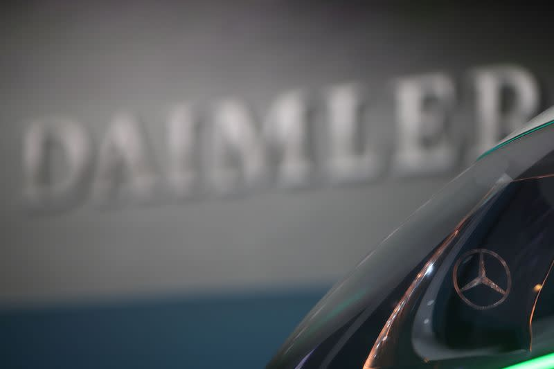 Daimler profits halve on diesel and restructuring charges
