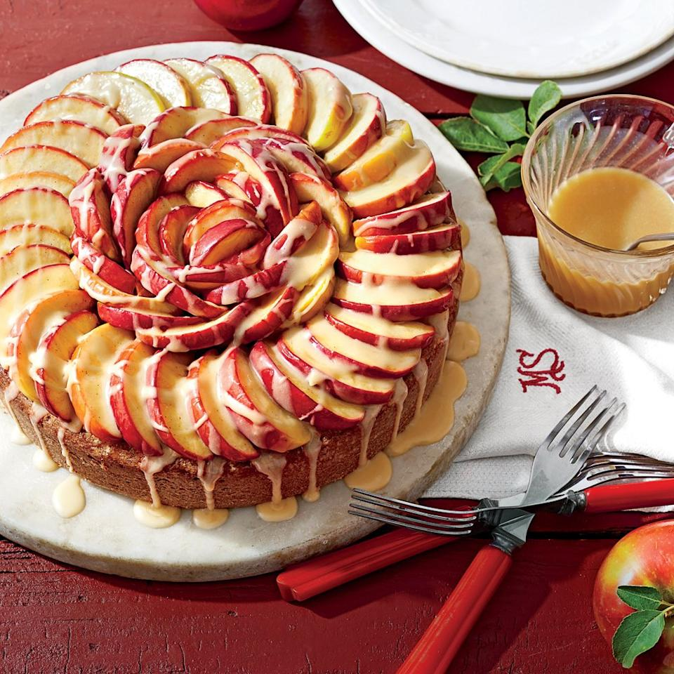 """<p>This cake is topped with sauteed apple slices and drizzled in a delicious <a href=""""https://www.myrecipes.com/recipe/apple-brandy-caramel-sauce"""">Apple Brandy-Caramel Sauce</a>. </p> <p><a href=""""https://www.myrecipes.com/recipe/caramel-apple-cake"""">Caramel Apple Cake Recipe</a></p>"""