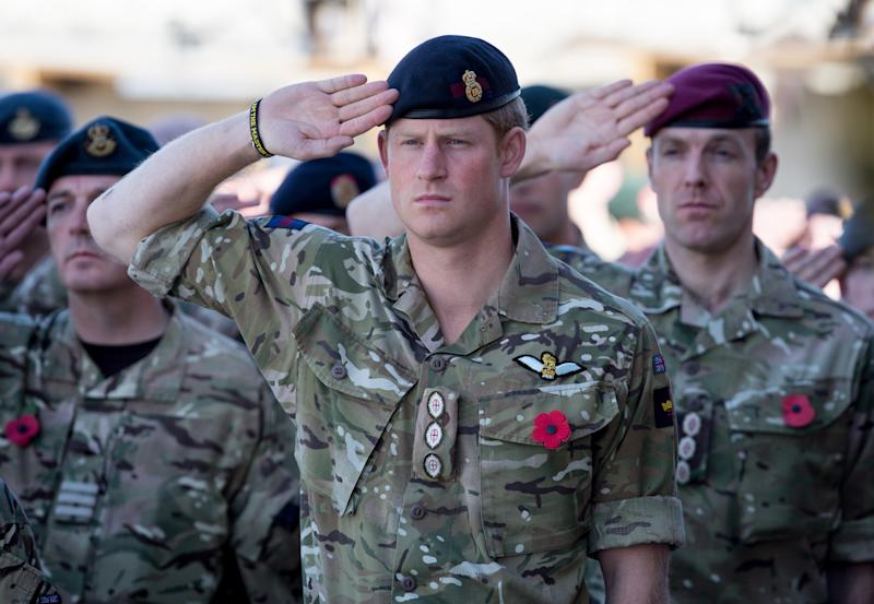 Prince Harry salutes in the army