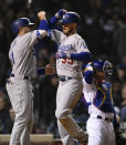 Los Angeles' Cody Bellinger (35) celebrates with teammate A.J. Pollock (11) at home plate after hitting a two-run home run during the sixth inning of a baseball game against the Chicago Cubs Wednesday, April 24, 2019, in Chicago. (AP Photo/Paul Beaty)