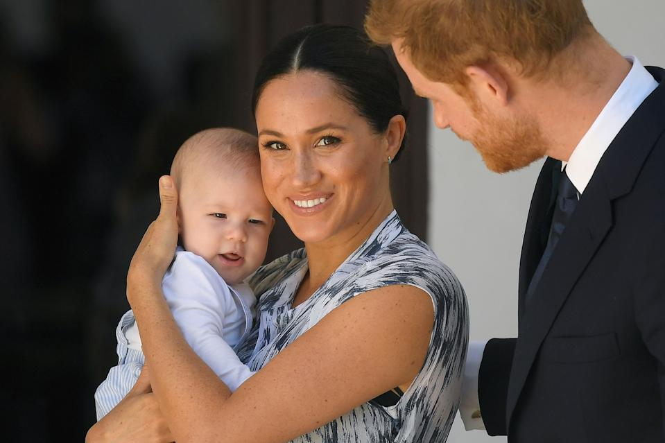 Britain's Prince Harry and his wife Meghan, Duchess of Sussex, holding their son Archie, meet Archbishop Desmond Tutu