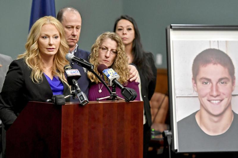Centre County District Attorney Stacy Parks Miller announces the findings of an investigation into the death of Timothy Piazza, flanked by his parents Evelyn and Jim (Abby Drey /Centre Daily Times via AP)