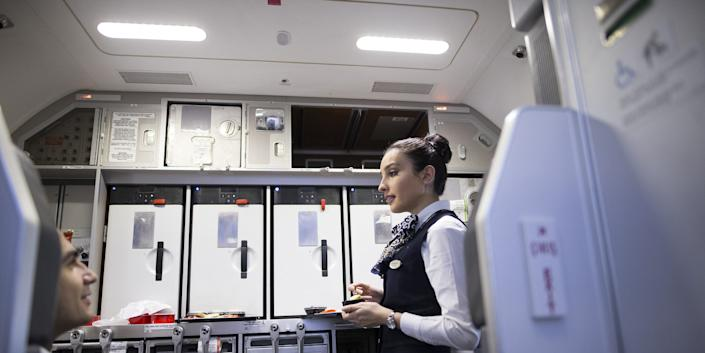Flight attendants are at high risk of catching the coronavirus in the confined space of an airplane cabin.