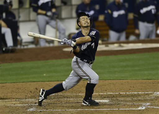 Milwaukee Brewers' Norichika Aoki loses his helmet while striking out against the San Diego Padres in the fourth inning of a baseball game in San Diego, Tuesday, April 23, 2013. (AP photo/Lenny Ignelzi)