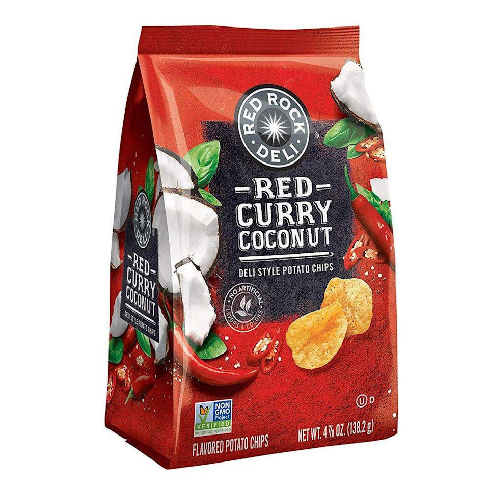 """<p><strong>Red Rock Deli</strong></p><p>amazon.com</p><p><strong>$11.99</strong></p><p><a href=""""https://www.amazon.com/dp/B0793M1XYL?tag=syn-yahoo-20&ascsubtag=%5Bartid%7C1782.g.28638254%5Bsrc%7Cyahoo-us"""" rel=""""nofollow noopener"""" target=""""_blank"""" data-ylk=""""slk:BUY NOW"""" class=""""link rapid-noclick-resp"""">BUY NOW</a></p><p>This Australian chip brand is quickly giving American classics a run for their money, with innovative flavors like red curry coconut. (Spicy and sweet? Sign me up.) It's the potato chip for folks who are just bored with basic nacho cheese.</p>"""