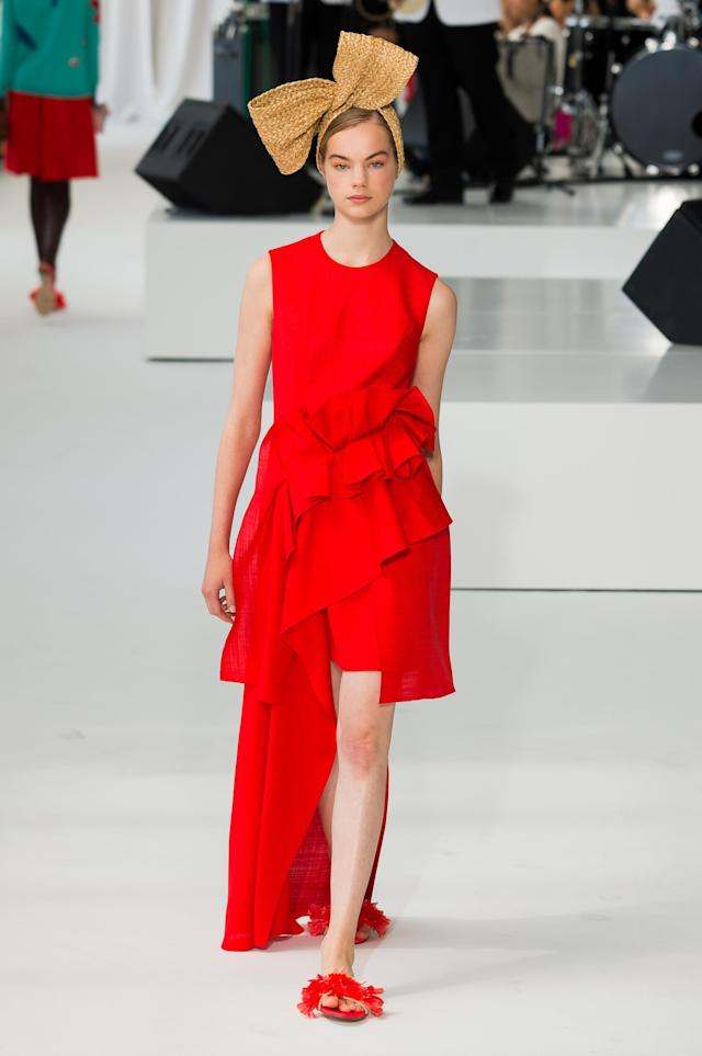 <p><i>Model wears a crimson, ruffle-tiered dress from the SS18 Delpozo collection. (Photo: ImaxTree) </i></p>