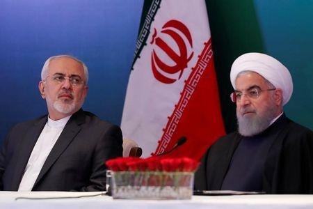 Iranian President Hassan Rouhani (R) and Foreign Minister Mohammad Javad Zarif attend a meeting with Muslim leaders and scholars in Hyderabad