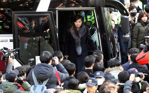 North Korean Hyon Song Wol, head of a North Korean art troupe, gets off a bus as she arrives at the Seoul Train Station - Credit: AP