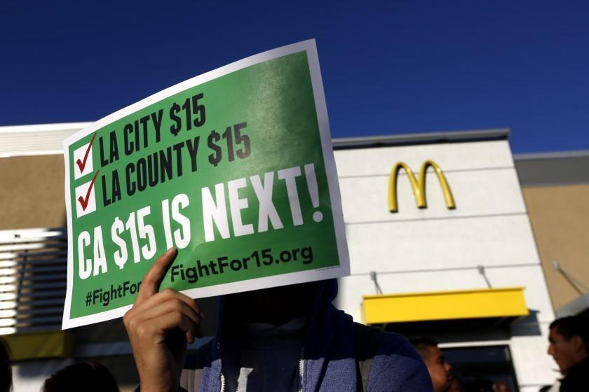 "Public pressure for a $15 minimum wage in California took shape in 2016, producing a law that will bring wages to that level in 2023. <span class=""copyright"">(Mark Boster / Los Angeles Times)</span>"