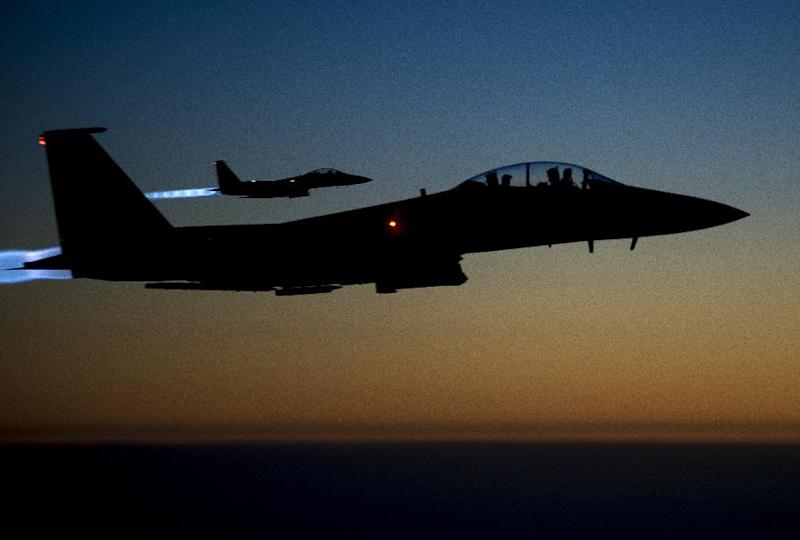 This US Air Forces Central Command photo released by the Defense Video & Imagery Distribution System shows a pair of US Air Force F-15E Strike Eagles flying over northern Iraq early on September 23, 2014 after conducting airstrikes