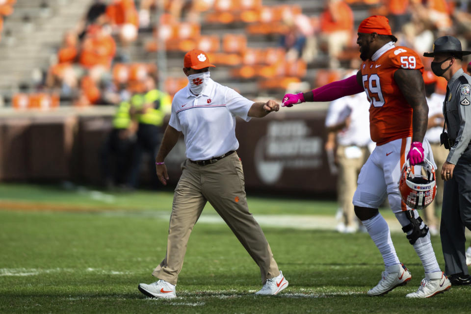 Clemson head coach Dabo Swinney fist bumps defensive tackle Jordan Williams (59) after an NCAA college football game against Syracuse in Clemson, S.C., on Saturday, Oct. 24, 2020. (Ken Ruinard/Pool Photo via AP)