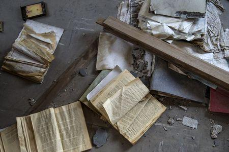 Books lie on the floor of an abandoned factory in the town of Elefsina, near Athens, Greece June 30, 2015. REUTERS/Marko Djurica